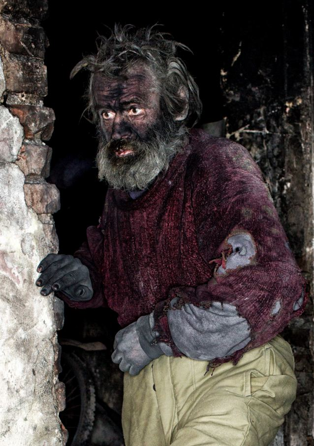 """Europe's dirtiest man Ludvik Dolezal who lives in a hovel and spends his nights in buried in HOT ASH. See SWNS story SWDIRTY; Homeless Ludvik Dolezal, 58, from Novy Bydzov, in the Czech Republic burns whatever he finds to create the dirty pile before crawling into it to sleep. He has even burnt his MATTRESS and DUVET in order to achieve the perfect mound of firey remains. Blackened Ludvik, who passers-by often refer to as a devil from fairytales, said: """"One day I simply decided to quit my job, that was a years ago. Since then I've staying here with the fire."""